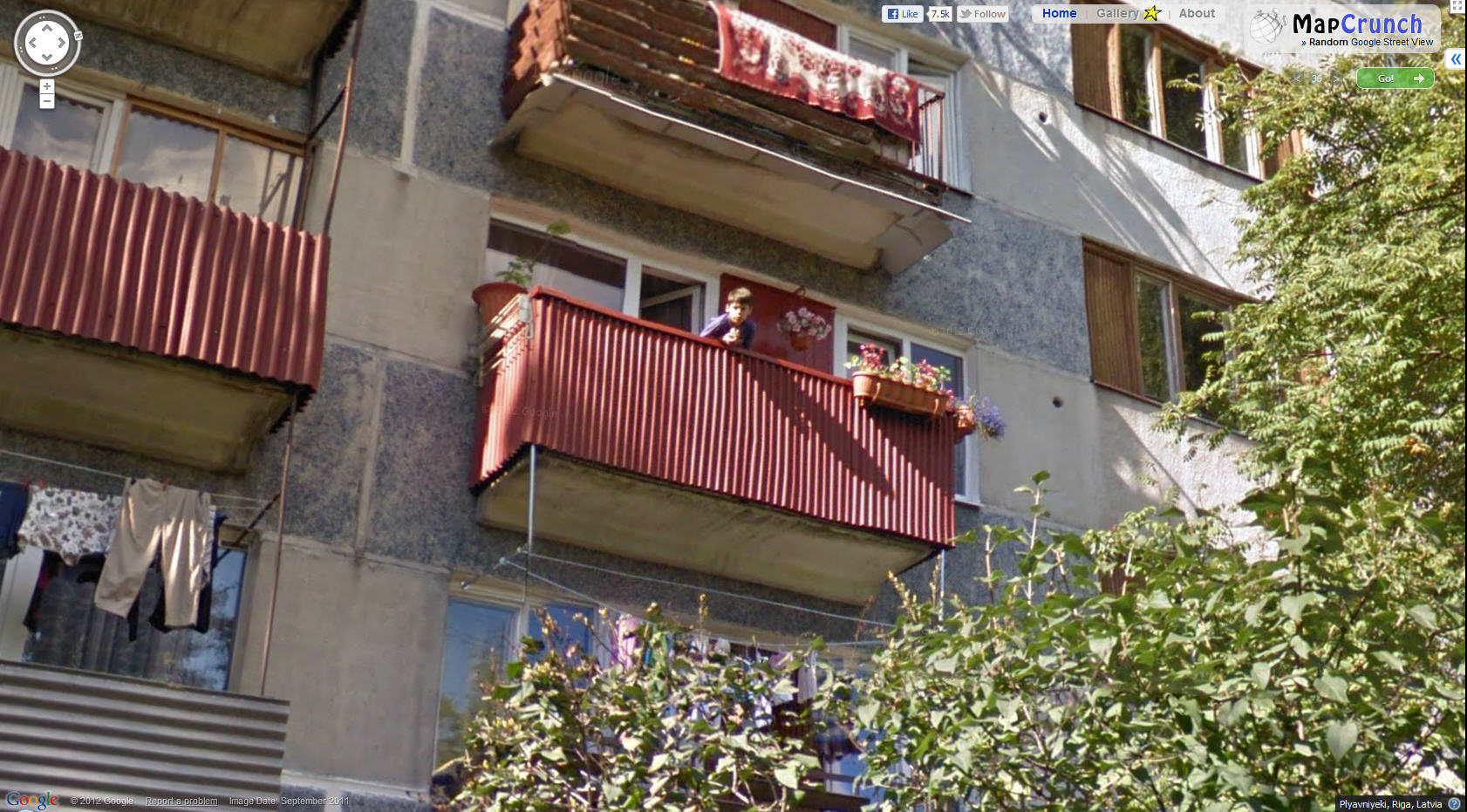 google-missed-blurring-this-latvian-boy-up-in-a-balcony