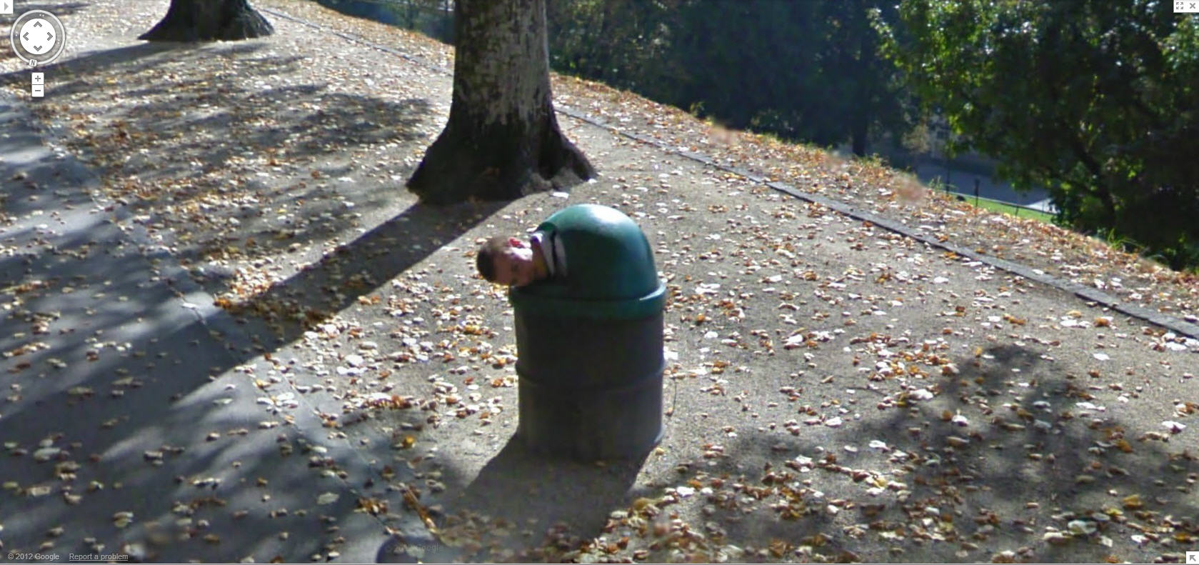 google-maps-street-view-switzerland-captures-a-guy-with-head-out-of-the-trash