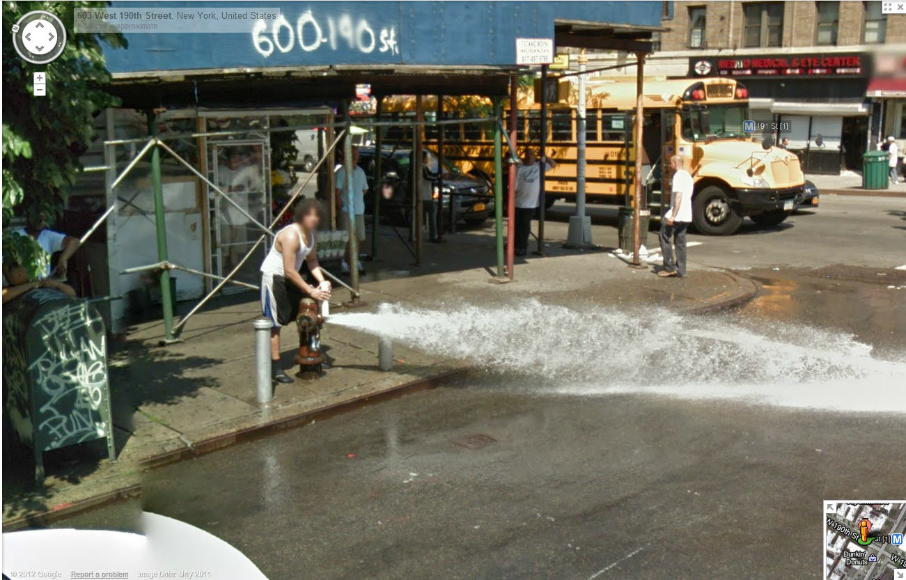 ny-afro-dude-fires-up-the-fire-hydrant-on-a-hot-day--