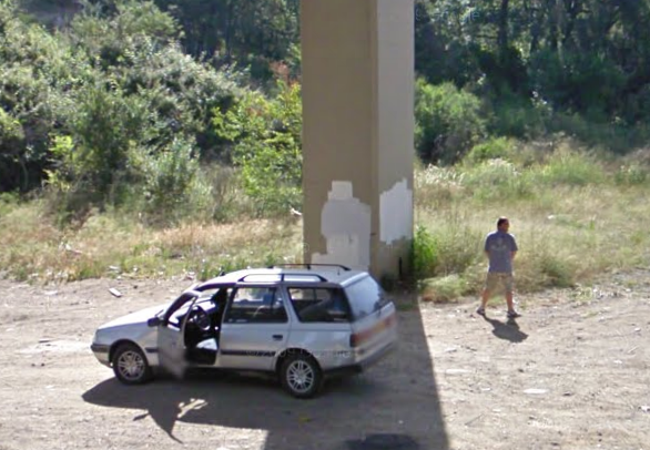 google-street-view-captures-a-guy-watering-the-grass-in-spain--
