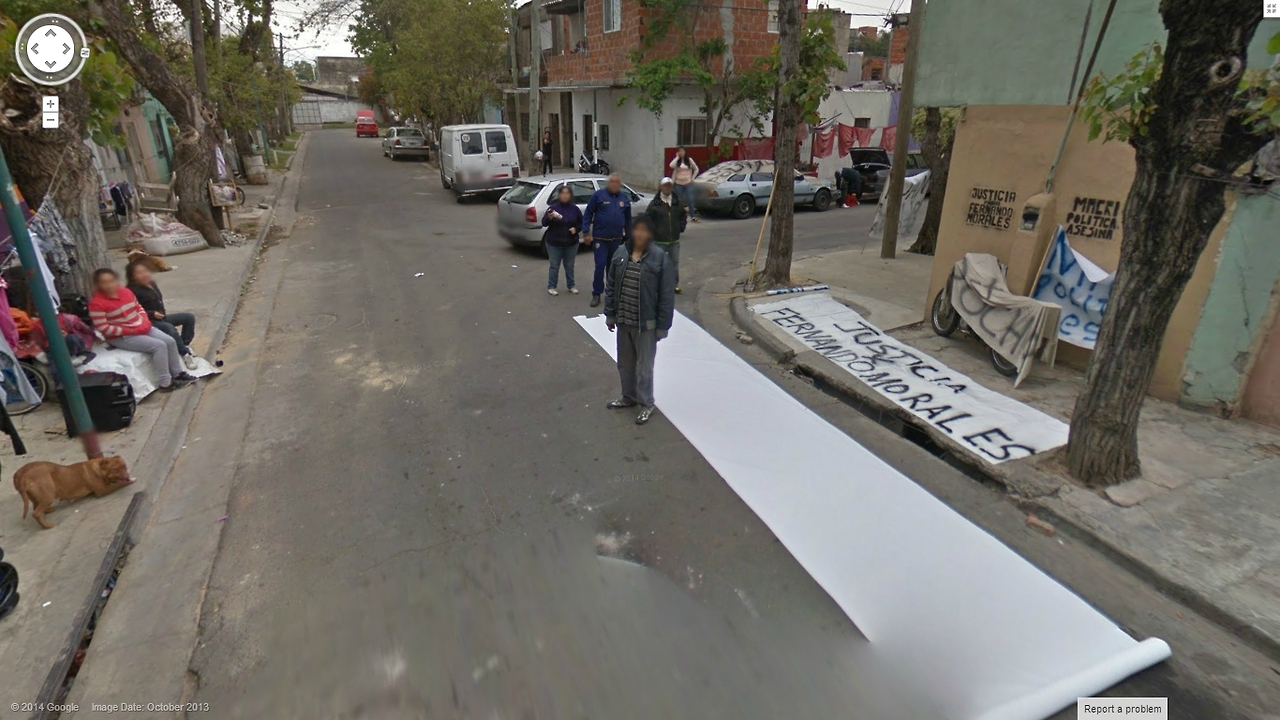 Argentinians Painting a Sign in the middle of the street