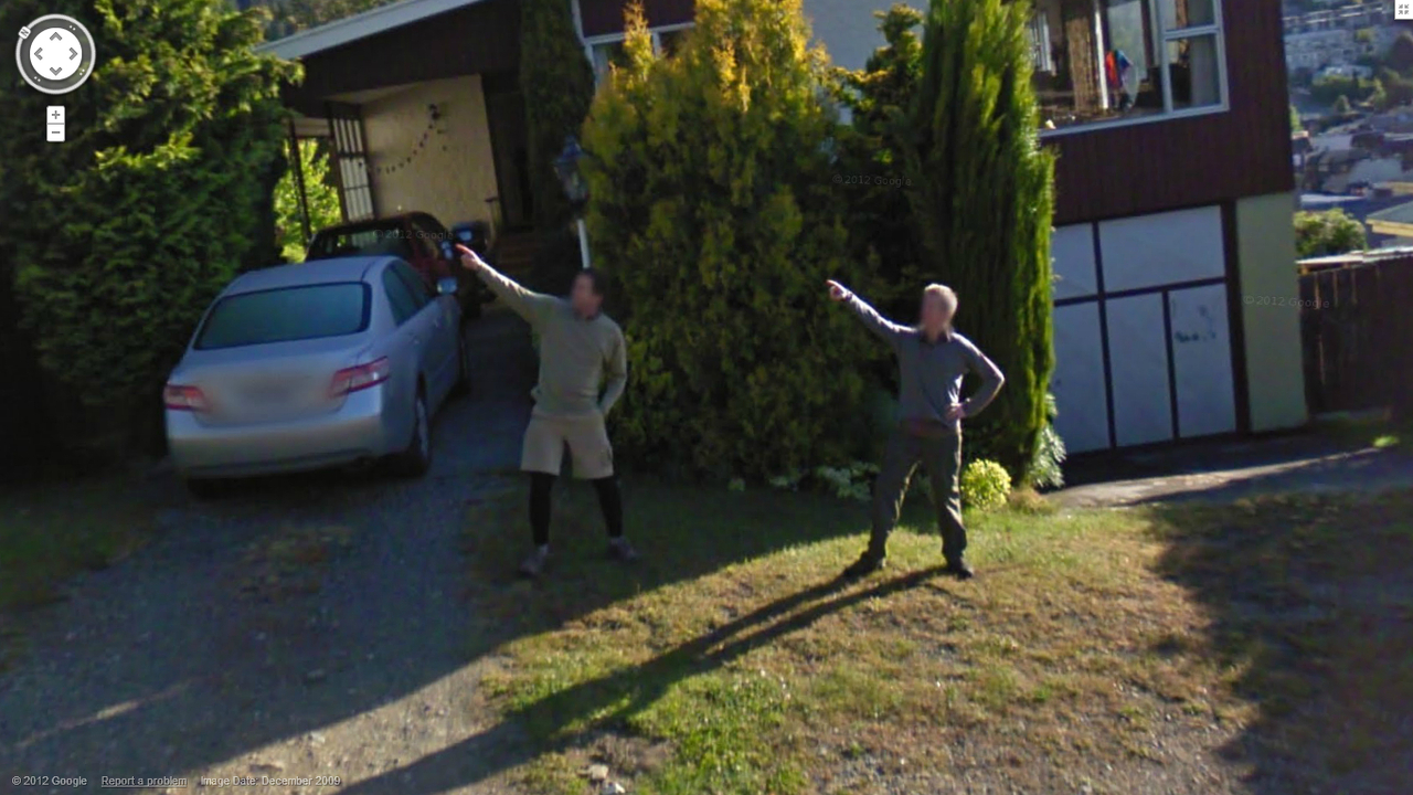 What are these guys pointing at?