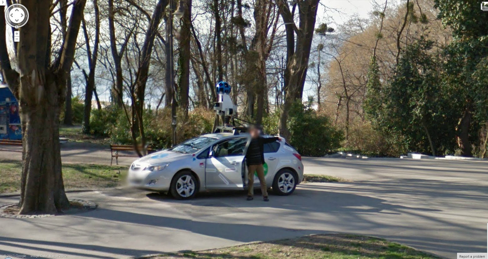 Google Street View driver photobombing another street view car.