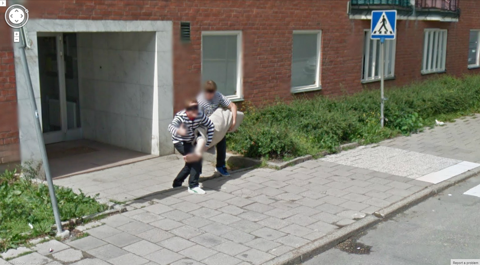 Two guys carrying a corpse caught on Google Street View!