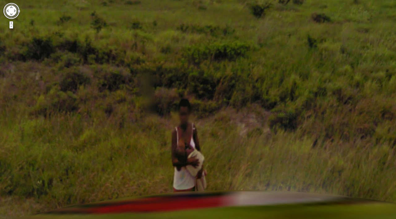 Thirsty? – African baby having breakfast on the run.