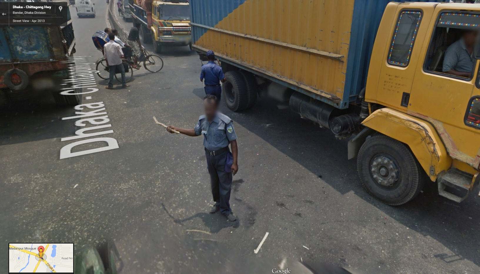 They give sticks to the traffic cops in Bangladesh