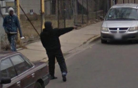 Thug shooting someone on the streets of Chicago