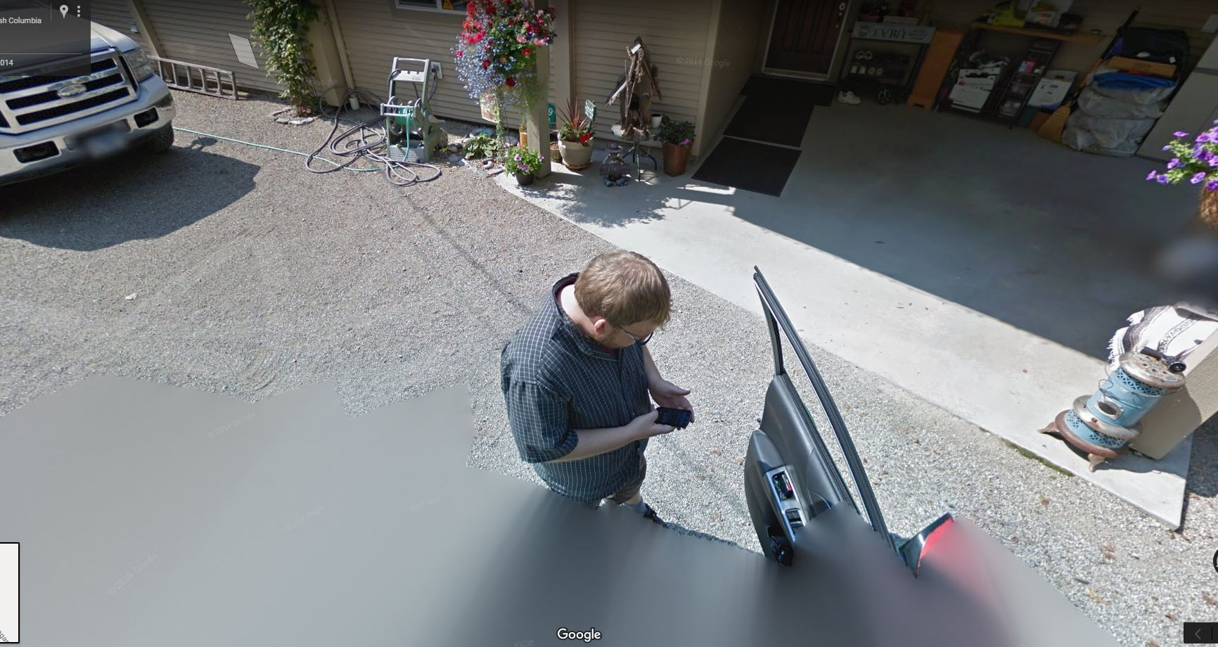 Google Street View Driver Lost – checking Google Maps for Directions